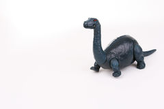 Toy dinosaur. Small plastic toy brontosaurus with moveable legs and mouth Royalty Free Stock Photos