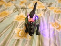 Toy dinosaur - big dinosaur with colorful lights flashing.  stock video footage