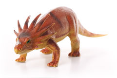 Toy Dinosaur. Orange Styracosaurus dinosaur toy isolated on white background Stock Images