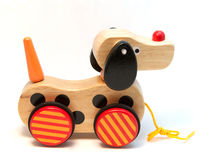 Toy dog. A child's toy wooden dog isolated on white stock photos