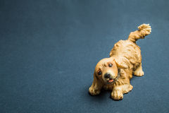 Toy of a dog against a dark background Royalty Free Stock Photo