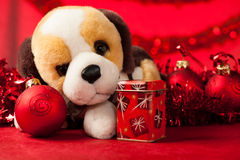 Toy dog with christmas ornaments Stock Image