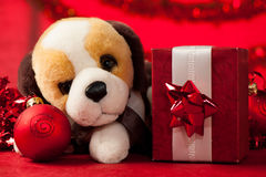 Toy dog with christmas ornaments Stock Photography