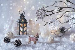 Toy dog Labrador in the frosty winter wonderland with snowfall and magic lights. stock image