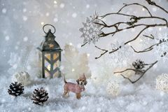 Toy dog Labrador in the frosty winter wonderland with snowfall and magic lights. New year greeting card royalty free stock images