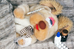 Toy dog is sick Royalty Free Stock Image