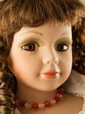 Toy doll. Closeup view of face of old doll Royalty Free Stock Image