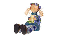 Toy doll. Seated little girl Stock Image