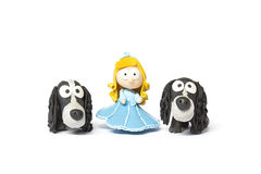 Toy doll with dogs on white Royalty Free Stock Photos