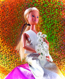 Teen doll. Toy doll in party dress with glittery background Royalty Free Stock Photography
