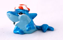 Toy dolphin. Isolated toy dolphin on white background Royalty Free Stock Photos