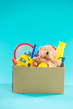 Toy. Donation box with  unwanted items for poor Royalty Free Stock Photo