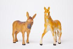Toy doneky and horse figurines Stock Photos