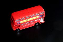 Toy Doubledecker. A toy Doubledecker on a black surface Royalty Free Stock Photos