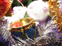 Toy drum on the Christmas tree Stock Photos