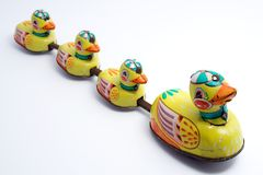 Toy Ducks in a Line. An old windup tin toy of one duck and three ducklings in a line Royalty Free Stock Photography