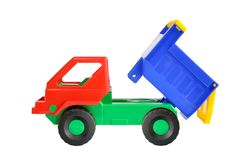 Toy dump truck. Out of colored plastic against white background Royalty Free Stock Photo