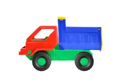 Toy dump truck. Out of colored plastic against white background Royalty Free Stock Photos