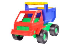 Toy dump truck. Out of colored plastic against white background Royalty Free Stock Photography
