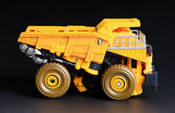 Toy Dump truck. Over black background Royalty Free Stock Image