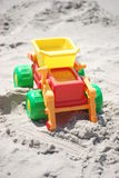 Toy dump truck in the sand Royalty Free Stock Images