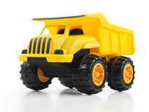 Toy dump truck. Yellow toy dump truck isolated on white background Royalty Free Stock Photography
