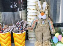 Toy Easter bunny and sweets on the counter of a street cafe stock photography