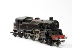 Toy Electric Model Train en el fondo blanco Fotografía de archivo