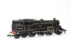 Toy Electric Model Train på vit bakgrund Arkivfoton