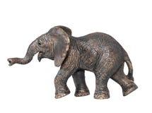 Toy elephant isolated on white background. Plastic toy elephant. Little  elephant walking isolated on a white background. The elephant is a symbol of the Royalty Free Stock Image