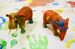 Toy Elephants painted by childrens on paper royalty free stock image