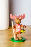 Toy elk with staff Stock Photos
