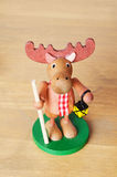Toy elk with staff Royalty Free Stock Photo