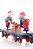 Toy Elves on Train Caboose Stock Images