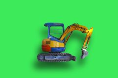 Toy Excavator. Small power shovel on a green background Stock Photography
