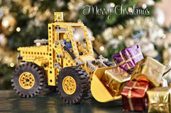 Toy excavator with Christmas gifts Stock Photos
