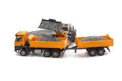 Toy excavator and heavy truck Stock Photo