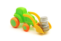 The toy excavator loads money. On white background Royalty Free Stock Photo
