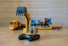 Toy excavator with raised bucket. Stock Photos