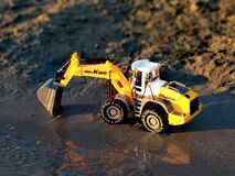 Toy excavator, in the sand
