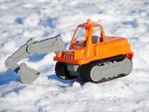 Toy excavator in the snow Stock Photo