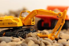 Toy excavator and tipper truck Royalty Free Stock Image