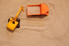 Toy excavator and truck in sand Stock Photo