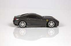 Toy Ferrari på vit bakgrund Arkivfoto