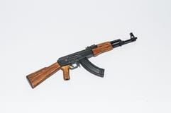 Toy figure gun Model ak miniature realitic white background Royalty Free Stock Photos