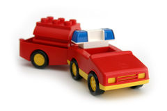 Toy fireman's car. Red fireman's car with tank in tow Stock Image