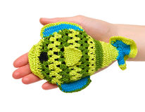 Toy - a fish. Hand-made toy - nice bright fish in female palm. Isolation Royalty Free Stock Image