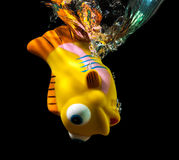 Toy fish and water splash. Royalty Free Stock Photo