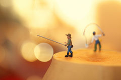 Toy fishermen Stock Photos