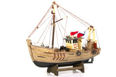 Toy fishing boat. On white background royalty free stock photo